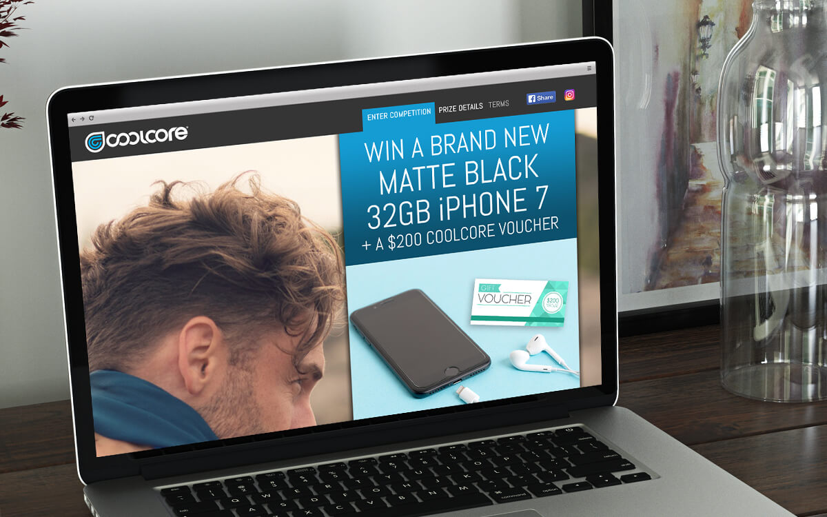 Competition website for Coolcore products on laptop computer
