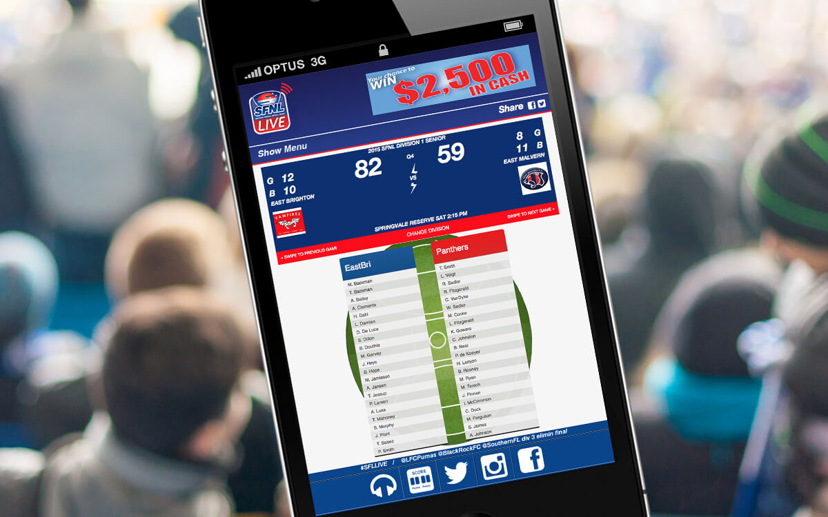 Man holding iPhone at game checking football scores