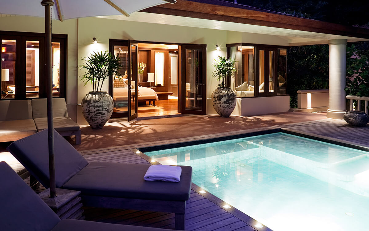 Outdoor scene with LED lights around pool area at night