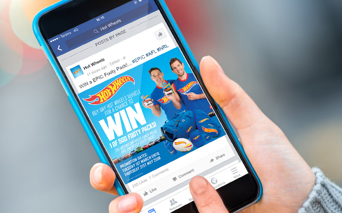 Person browsing Facebook post with Hot Wheels promotion