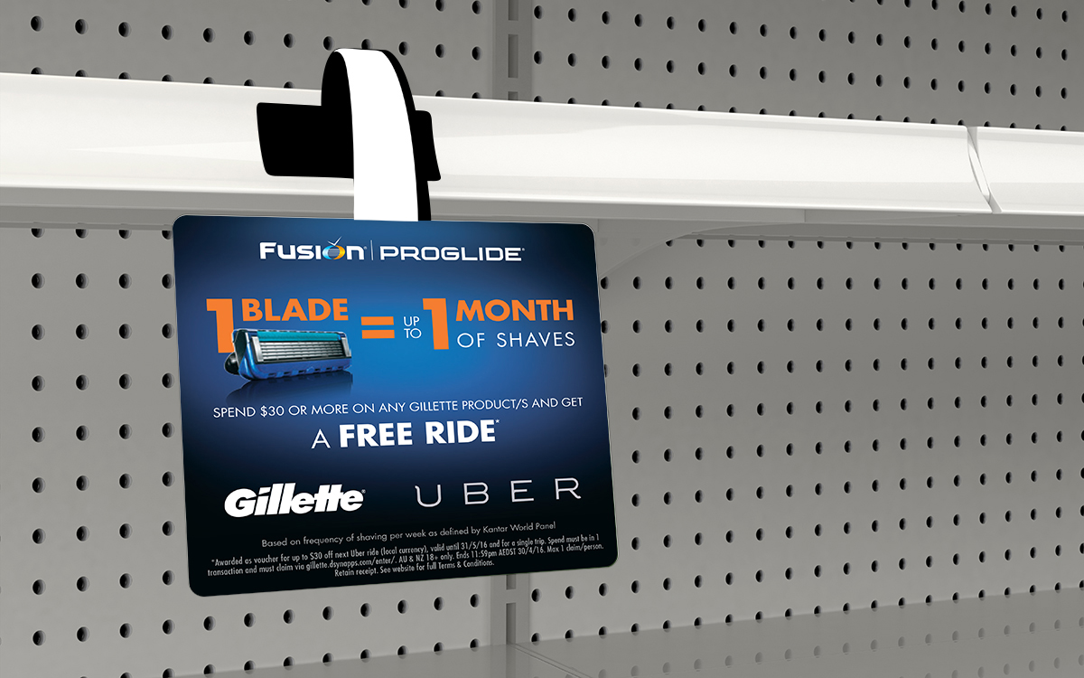 Wobbler on shelf featuring Gillette Uber promotion